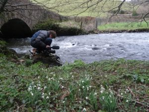Simon filming the river Yeo flowing towards Phil's farm